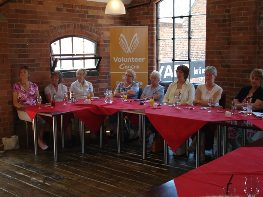 Lunch Club Volunteers paying rapt attention at the Yard, Swadlincote
