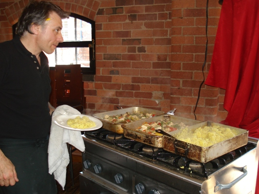 Chef Stefan Serving the food prepared at the Yard Swadlincote for the Volunteers Week Cookery Demonstration