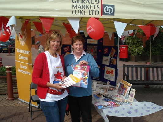 Chris and Carole from Girlguiding at the market stall for Volunteers Week 2009 on the Delph, Swadlincote