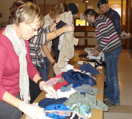 Make A Difference Day - Volunteers sorting donated clothes